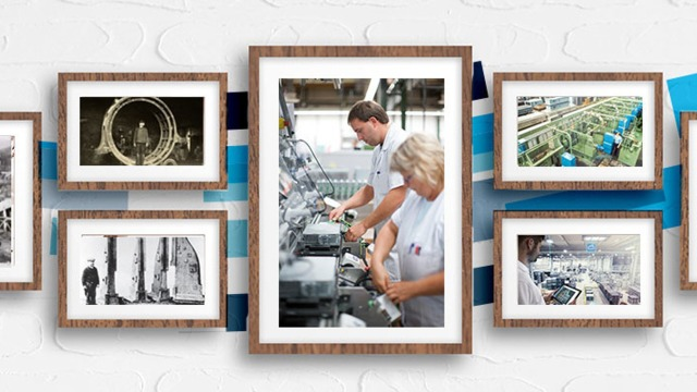 Photos of factories and manufacturing on a wall