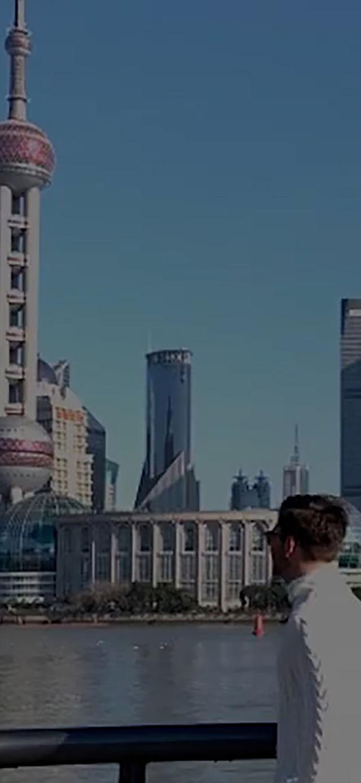 Man against Shanghai skyline